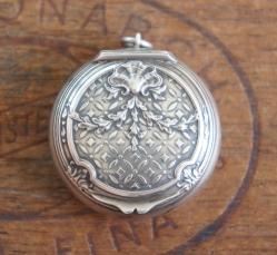 Silver powder compact pendant