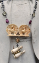 Necklace with carved bone peacocks and mini binoculars