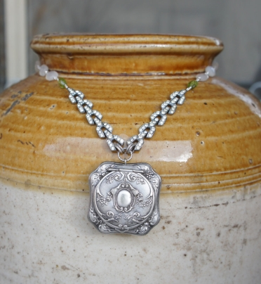 Necklace with antique powder puff pendant and rhinestones