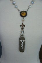 Necklace with small leather purse and rhinestones