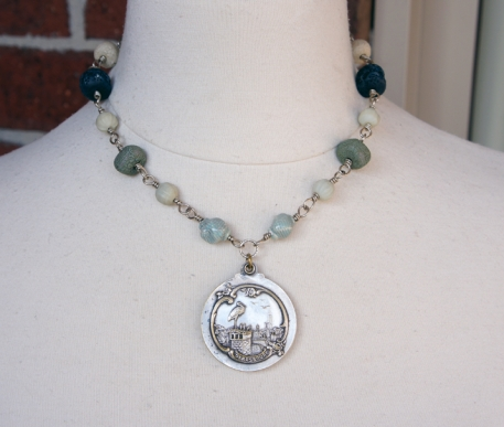 Necklace with an antique mirror locket
