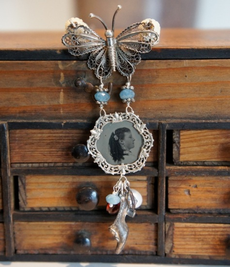 Necklace with picture pendant, a butterfly and a silver shoe