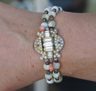 Bracelet with vintage rhinestone clasp and coral
