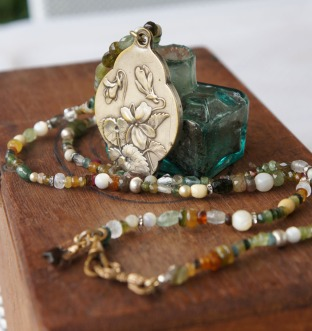 Another favourite - a multi gemstone strand with a mirror locket