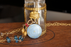 Necklace made with antique enamel locket and rubies