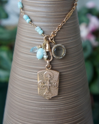 Necklace made with antique locket and baby blue Amazonite stones