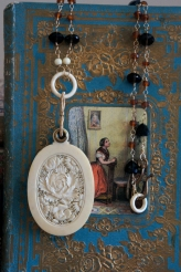 Necklace made with ivory mirror locket