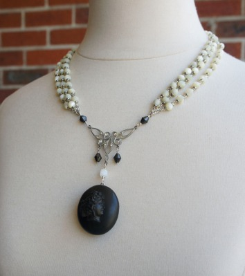 Necklace made with Victorian mourning locket and multi strands of mother of pearl beads