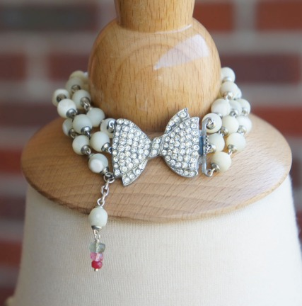 Bracelet made with rhinestone bow clasp and mother of pearl beads
