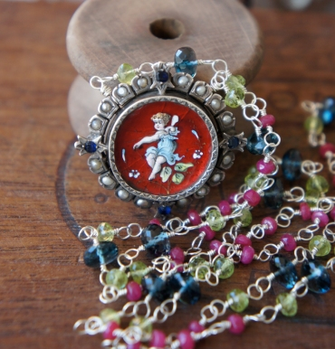 Necklace made with multi colour gemstone chain and rare enamel cherub brooch